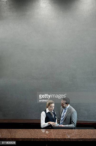 Hotel manager talking to woman in the reception