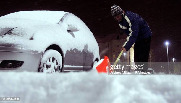 Hotel nightporter Gregory G sweeps snow from the car park of the Aviemore complex early Friday November 25 as snow fell over night Parts of Scotland...