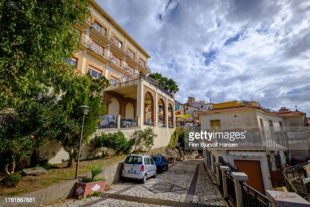 castelmola, sicily, italy - november 8, 2019: hotel, old buildings and narrow road in castelmola center - finn bjurvoll ストックフォトと画像