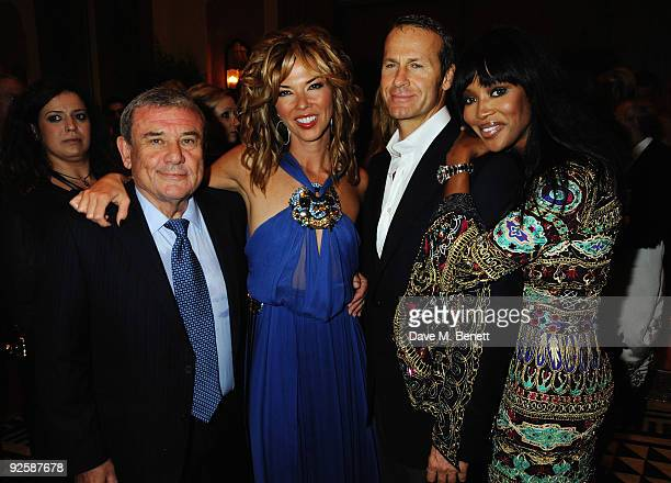 Hotel owner Sol Kerzner and wife Heather Kerzner pose with model Naomi Campbell and boyfriend Vladislav Doronin during for the grand opening night of...