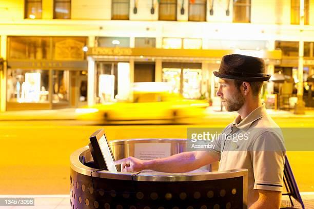 Hotel parking valet at outdoor kiosk.