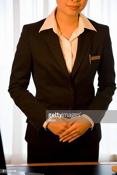 Hotel receptionist standing