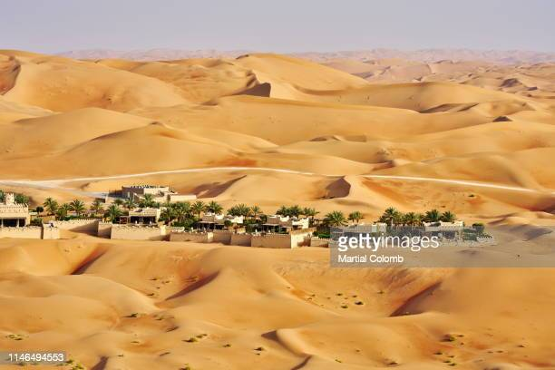 hotel resort among  sand dunes - martial stock pictures, royalty-free photos & images