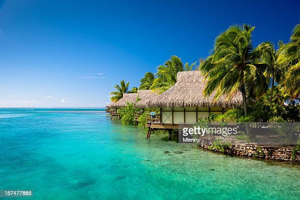 hotel resort in paradise lagoon - tahiti stock pictures, royalty-free photos & images