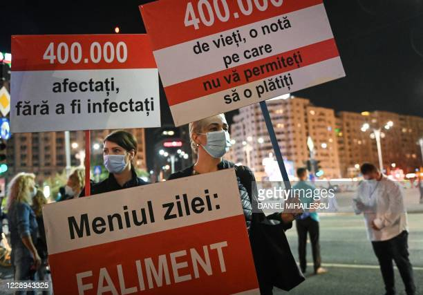 """Hotel, restaurant and cafe employees protest with placards reading """"The course of the day: Bankruptcy"""" , """"400,000 people affected, not infected""""..."""