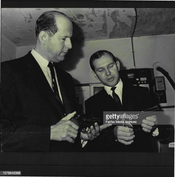 Hotel Robbery Jack Green of the Nelson Hotel Woollahra and Max Harvey representative of Colt in Australia Green is holding a Python 357 magnum with a...
