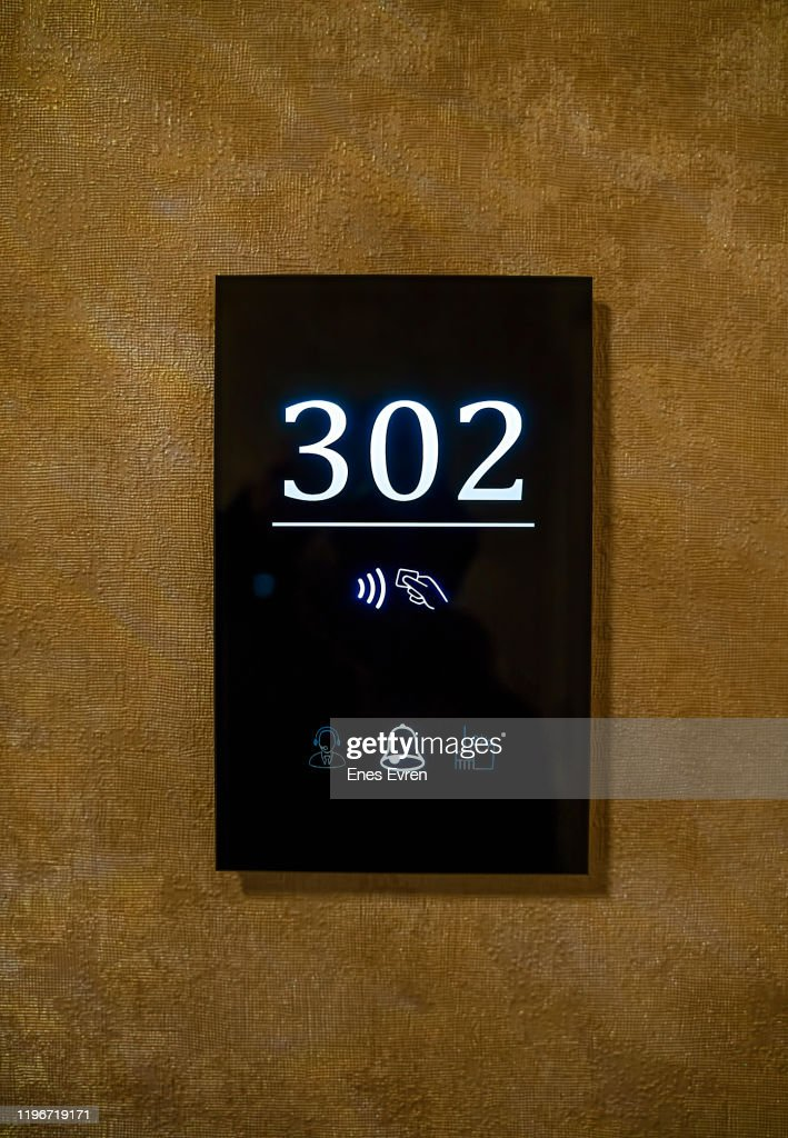 Hotel room door number, touchless electronic lock : Stock Photo
