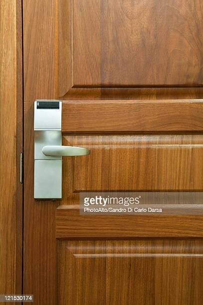Hotel room door with electronic door lock, full frame