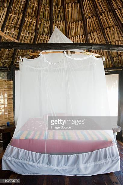 hotel room in beach hut - mosquito net stock photos and pictures