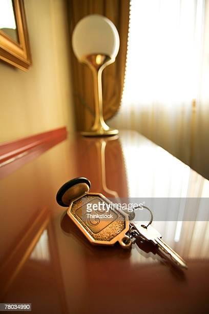 Hotel room key on table