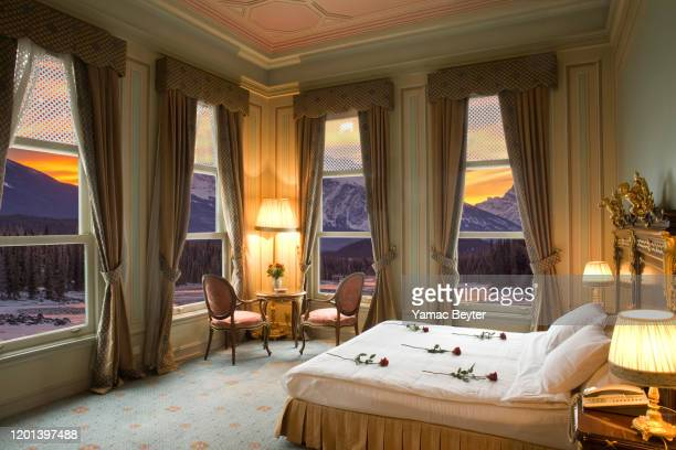 hotel room with panoramic view of the mountains - honeymoon stock pictures, royalty-free photos & images