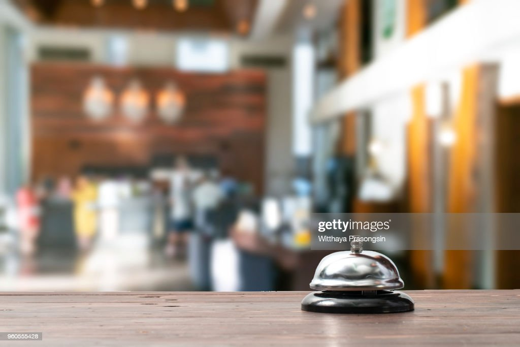 """Hotel service bell on a table white glass and simulation hotel background. Concept hotel, travel, room""""n : Foto de stock"""