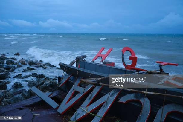 A hotel sign damaged by a tsunami at a resort hotel on December 23 2018 in Tanjung Lesung Indonesia Over 220 people have reportedly been killed after...