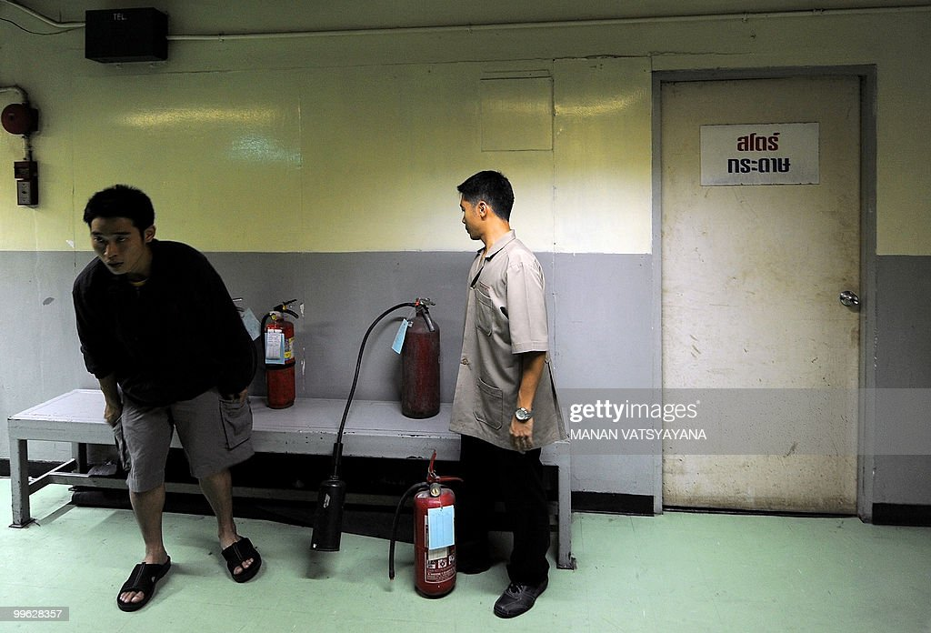 Hotel staff arrange fire extinguishers i : News Photo