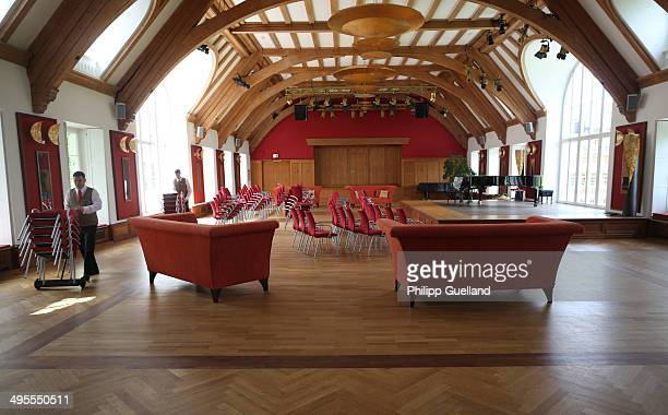 Hotel staff move chairs in a concert hall at Schloss Elmau, a luxury spa hotel, in the Bavarian Alps of southern Germany on June 3, 2014 in Kruen...