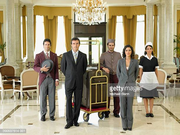 Hotel staff standing in foyer, portrait
