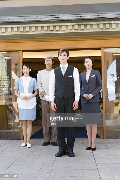 hotel staffs, smiling, portrait, low angle view - ホテルマン ストックフォトと画像