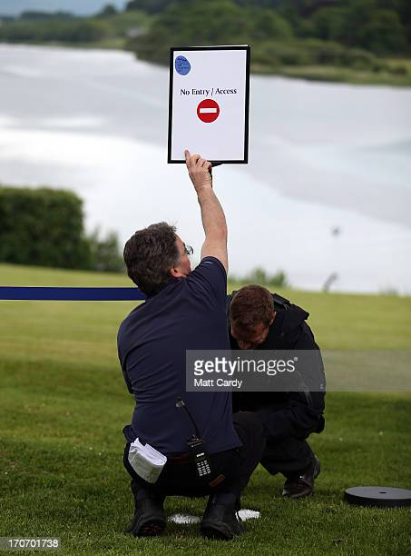 Hotel workers erect a sign in the grounds of the Kellyhevlin Hotel which is being used as the G8 media centre close to the G8 venue of Lough Erne on...