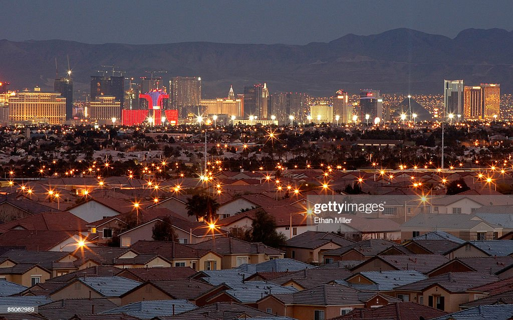 Hotel-casinos on the Las Vegas Strip are seen behind homes February 24, 2009 in Las Vegas, Nevada. Home prices in Las Vegas fell by 33 percent compared to the same period last year according to the Standard & Poors/Case-Shiller index for the fourth quarter of 2008. Las Vegas' slide was the second worst of the 20 cities tracked by the index, which also shows that national home prices dropped 18.2 percent in the fourth quarter, the largest slide in the index's 21-year history. In addition, the Federal Housing Finance Agency on Tuesday reported an 8.2 percent drop in home prices from a year earlier, its largest annual decline recorded since 1991.