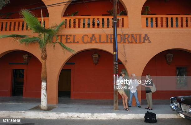 Hoteliers Witold Twardowski and John Stewart talk with an unidentified woman outside their coowned property Hotel California Todos Santos Baja...