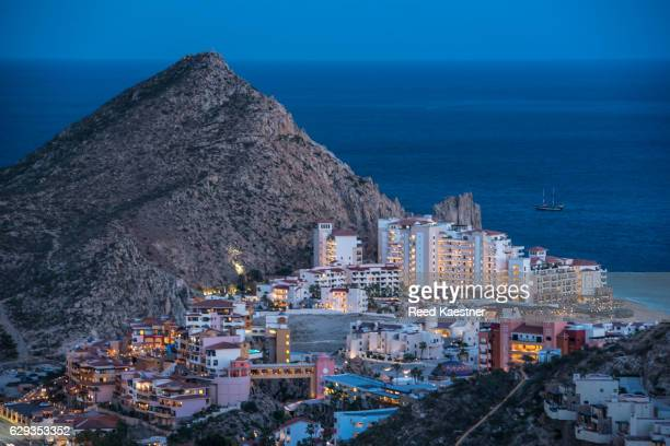 hotels in evening light at land's end, near the harbor at cabo san lucas. - sailfish stock pictures, royalty-free photos & images