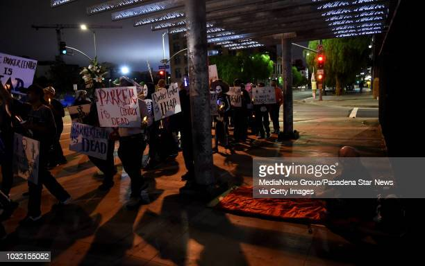A hotels man looks on during a housing and homeless advocates funeral procession and Candlelight March to mourn the destruction of the former LA...