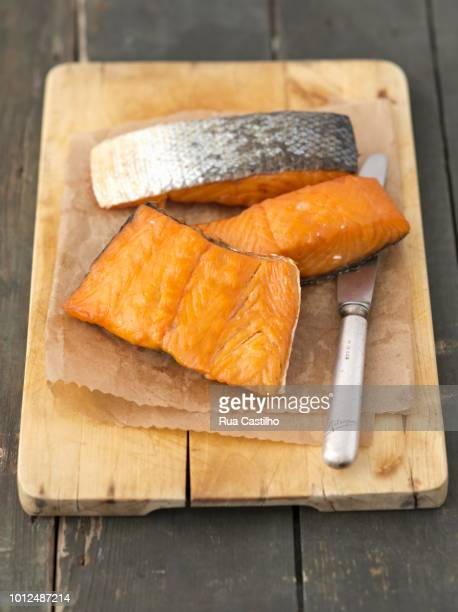 hot-smoked salmon on a chopping board - rua stock pictures, royalty-free photos & images