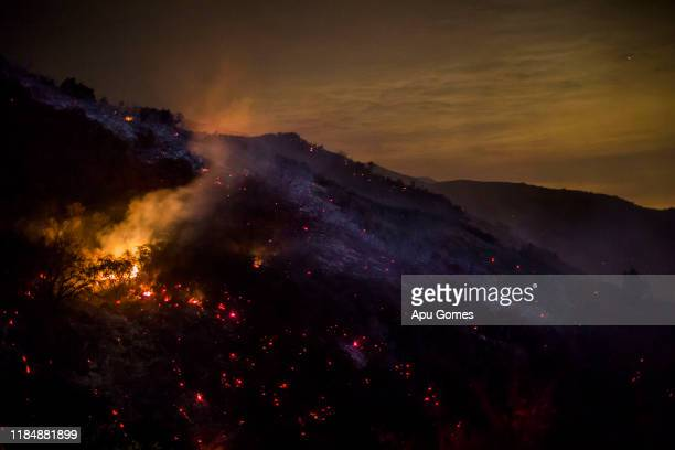Hotspots burn during the Cave Fire at the Los Padres National Forest on November 26 2019 in Santa Barbara California Fire officials say the fire is...