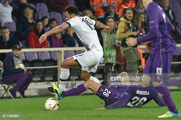Hotspurs midfielder from Belgium Mousa Dembele Tottenham fights for the ball with Fiorentina's defender from Spain Marcos Alonso Mendoza during the...