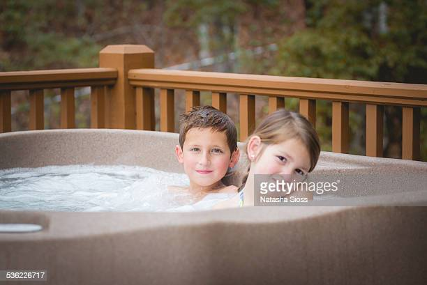 hottub fun - girls in hot tub stock photos and pictures