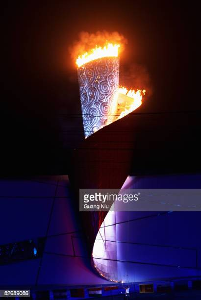 Hou Bin Chinese athletics paralympic gold medallist ligths the torch during the Opening Ceremony for the 2008 Paralympic Games at the National...