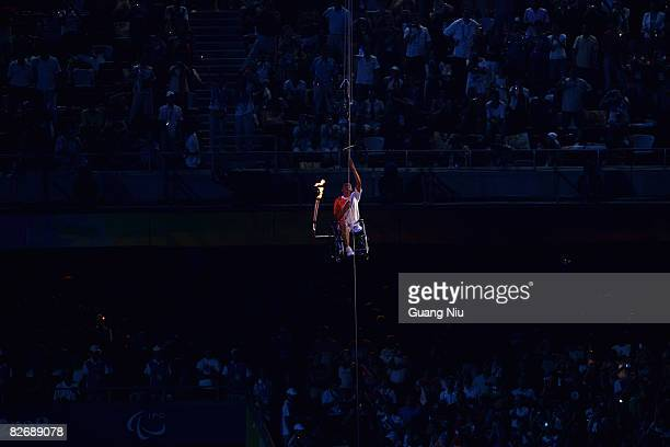 Hou Bin Chinese athletics paralympic gold medallist rose himself up to ligth the torch during the Opening Ceremony for the 2008 Paralympic Games at...