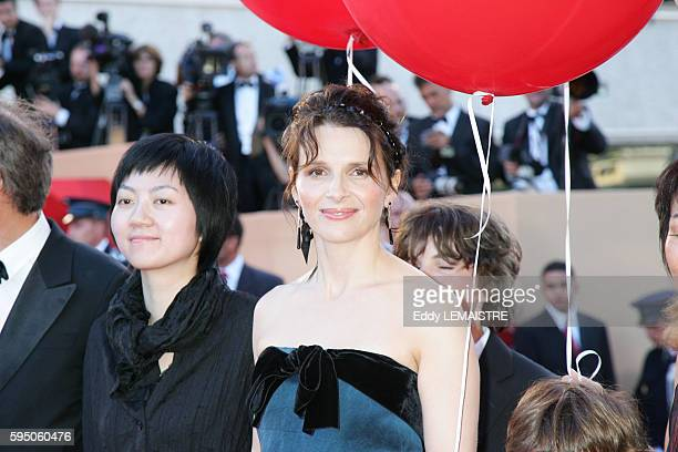 Hou Hsian Hsien and Juliette Binoche arrive at the premiere of 'Zodiac' during the 60th Cannes Film Festival