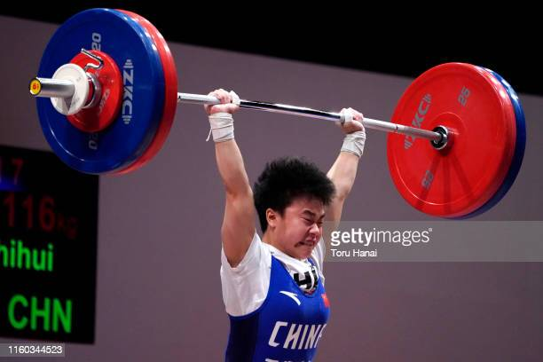 Hou Zhihui of China competes in the women's 49kg weightlifting on day one of the Ready Steady Tokyo - Weightlifting, Tokyo 2020 Olympic Games test...