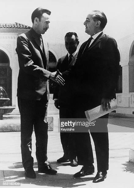 Houari Boumediene Chairman of the Revolutionary Council of Algeria greets French Secretary of State for Algerian Affairs Prince Jean de Broglie...