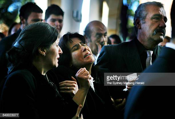 Houda Nassif is comforted by Family and friends at St Charbel's Orthodox Catholic Church for the funeral of Jehan Nassif 18 yrs from Yagoona who died...