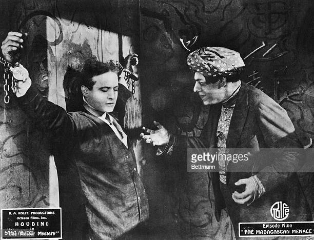 Houdini chained up in the motion picture 'The Master Mystery Episode Nine 'The Madagascan Menace' B A Rolfe Productions Octagon Films Inc