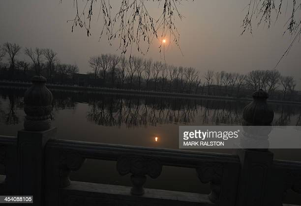 Houhai Lake is shrouded in heavy air pollution as the PM 25 index reaches 467 which is considered 'hazardous' in Beijing on December 7 2013 Cities...