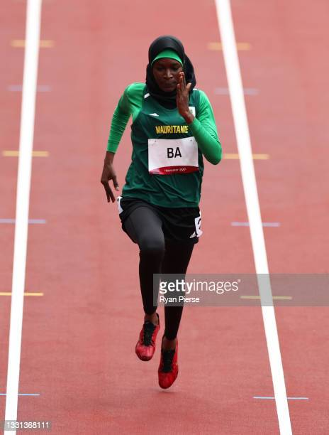 Houleye Ba of Team Mauritania competes in the Women's 100 metres Preliminary Round heats on day seven of the Tokyo 2020 Olympic Games at Olympic...