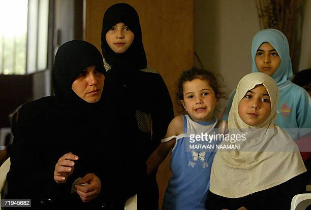 The mother sisters and cousins of Ali Jouma a 12yearold victim of an Israeli cluster bomb that exploded in his right hand cutting off his thumb and...