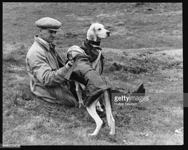 Hounds and their owner before a hound race in northern England in the 1930s | Location Selside Yorkshire England UK