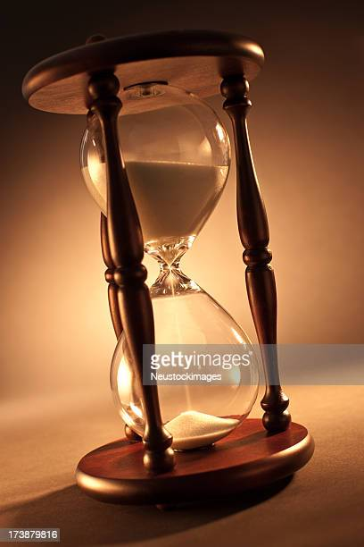 Hour glass over isolated background