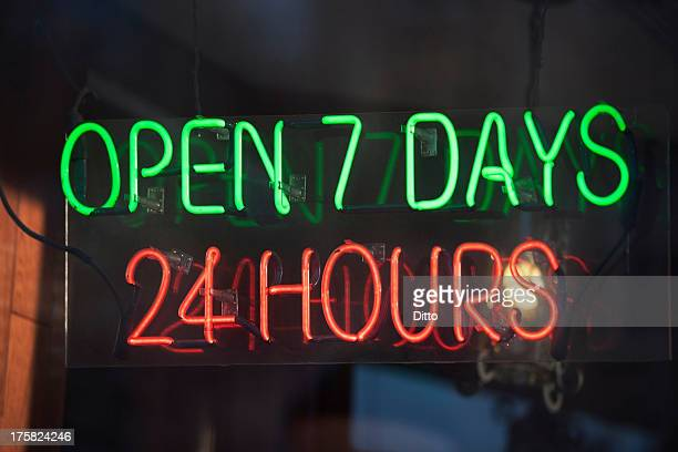 24 hour illuminated neon sign - convenience stock photos and pictures