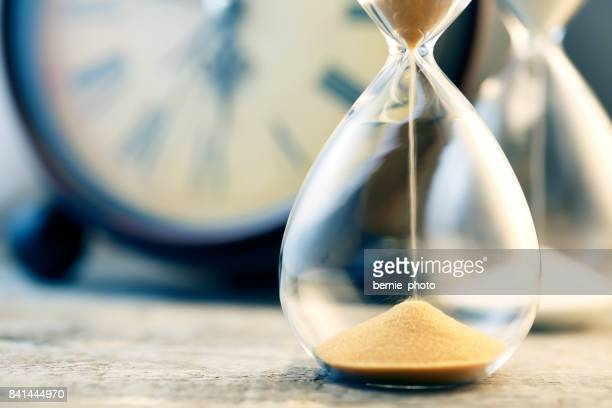 hourglass flow - countdown stock photos and pictures