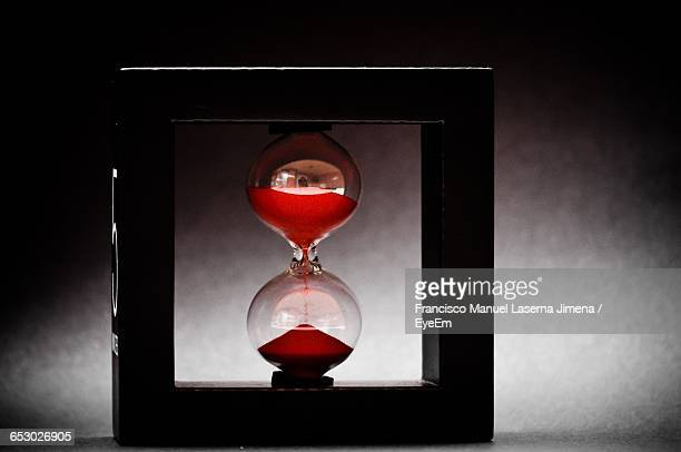 hourglass in frame against wall - countdown clock stock-fotos und bilder