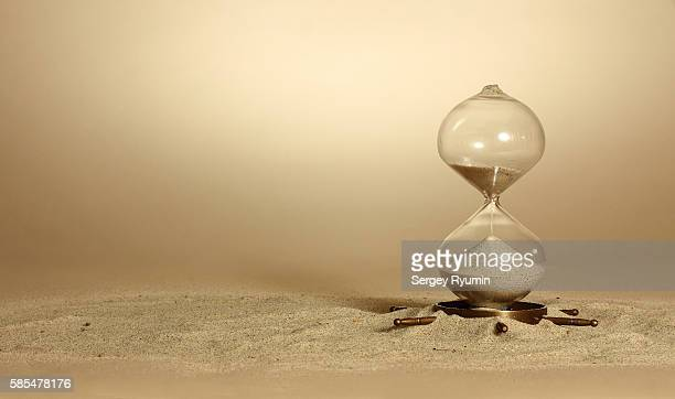 Hourglass on beige background