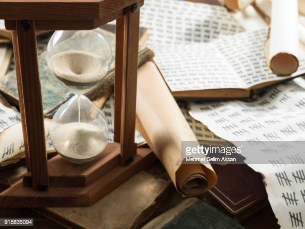 Hourglass, Scrolls, And Antique Books With Tally Marks