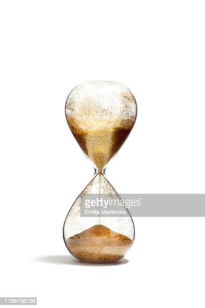 hourglass with golden sand on white background - ampulheta imagens e fotografias de stock