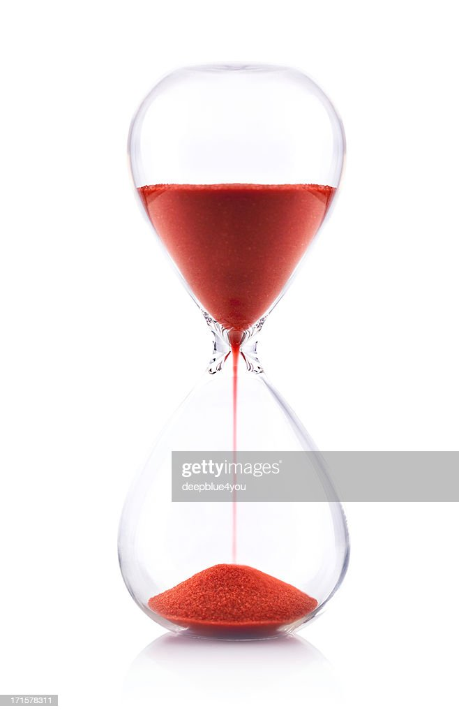 Hourglass with red sand on white background - Time concept : Stock Photo