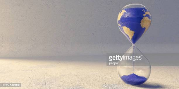 hourglass with sand pattern of countries of the world - world map stock pictures, royalty-free photos & images